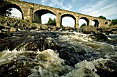 The River Tyne, flowing beneath the Alston Arches at Haltwhistle, Northumberland on Sunday 22nd August 1999. The viaduct is situated on the former Haltwhistle to Alston branch.