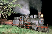 A night freight train leaves Santa Fe on Argentinas metre gauge Belgrano Railway behind an 8A class oil burning2-6-2 Prairie built by Societe Suisse in 1909, Originally there engines were wood burners. A picture dated 20 March 1979.