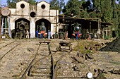 The rebuilding of Eritreas railway between Masawa on the Red Sea Coast and Asmara the capital, following 30 years of abandonment and Civil war, was little short of miracle. This scene of the steam depot in Asmara in 1998 shows 0-4-0 Well Tank built by Breda of Milan in various stages of overhaul. Many artisans long since retired were recalled to spearhead the renaissance of this former Italian colonial railway albeit that many were in their 70s and 80s.
