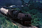 An East African Railways Mountain Class 2-8-4 + 4-8-2 Garratt climbs the steep coastal escarpment out of Mombasa on the first lap of its 330 mile journey to Nairobi. Picture made in 1973.