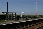 General view of the platform, waiting shelter and lighting at Rhosneigr station, Anglesey, North Wales. 2007