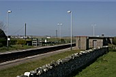 General view of the platform, waiting shelters and lighting at Rhosneigr station, Anglesey, North Wales. 2007