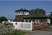 The signal box and level crossing at Ty Croes station, Anglesey. 2007