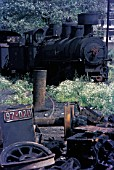 A tale of two engines. On the scrapline at Sarajevo ( Alipasin Most) the remains of a Yugoslav Railways 26 gauge rack/ adhesion 97 Class 0-6-4 make contrast with a condemned Class 83 0-8-2.