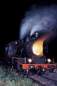 Night time at Sid Depot in Serbia with Yugoslav Railways Class 20 2-6-0 Mogul No.20 131.  Hot ashes are being raked out of the smokebox on Thursday 25 August 1983.