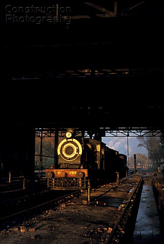 The late afternoon sun shines through the motive power depot at Malakwal in the Pakistans Punjab and