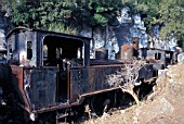 The stunted bushes and rocks of the Greek Peloponnese Peninsular make a fine setting for a meter gauge Z Class 2-6-0T on the Acladokampos locomotive dump. Loco Number 7510 built by Societe Alsacienne Graffenstaden France 1899. Friday 6 August 1982.