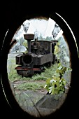 Picture in the Feldbahn locomotive graveyard at Czarna Bialostocka in north eastern Poland close to the Russian border. The engine is Class Tx232 Henschel builders numbers 14015 of 1916. The 600mm gauge Feldbahns were one of the most numerous war engines and the last survivors ended their days at Czarna Bialostocka. Picture dated May 1983.