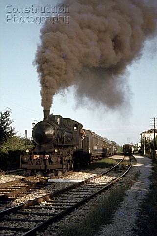 A Mantova  Cremona train makes a smokey departure from Bozzolo behind Italian Railways Class 625 260