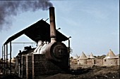 Sennar Junction in the Sudan on Monday 10th January 1983. The stationary boiler is from North British Locomotive Company No. 23591 of 1927.