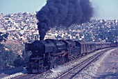 A former German Kreigslokomotiv 2-10-0 climbs away from Izmir with the 08.00 mixed to Afyon on Saturday 21st August 1976.
