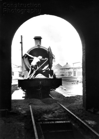 Shovelling hot ashes from the smoke box of a former a LNER Q6  080 at West Hartlepool depot in the m