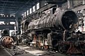 A China Railways RM Class Pacific 4-6-2 undergoes a heavy overhaul at Changchung Loco Works in 1986.