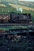 Merthyr Vale Colliery, Aberfan in Mid Glamorgan, South Wales with No.1, an 0-6-0T built by Andrew Barclay of Kilmarnock in 1953. In 1966, one of the collierys slag tips collapsed on to part of Aberfan killing 144 people including 116 children who were in school and in the area covered by the falling sludge. Tuesday 21st December 1971.