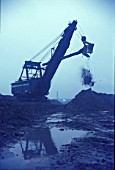 Digger at work on the mines which surrounded the vast Corby Steelworks situated on the Northamptonshire ironstone bed.