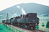 A pair of Austrian Railways 93 Class 2-8-2Ts double head a passenger train in 1970.