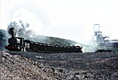 Pennyvenie Mine on the Waterside colliery system in Ayrshire with West Ayr Area No.21, an Andrew Barclay 0-4-0ST of 1949, heading a rake of wooden bodied wagons in May 1972.