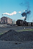 Industrial landscape on the Cumbrian coalfield featuring a Giesl chimney Hunslet Austerity 0-6-0ST. June 1971.