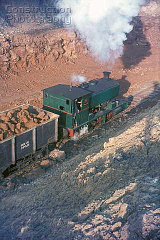 An Andrew Barclay 040ST storms out of the ironstone mine with a loaded train A picture on the Storef