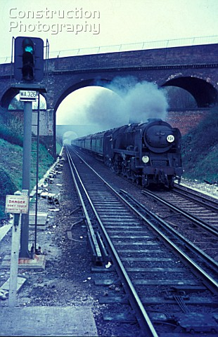 An up express races through Winchester behind former Southern Railway Bulleid rebuilt Merchant Navy