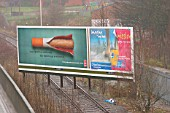 Advertising hording takes over the tracks on the disused branch line from Luton to Dunstable. January 2004.