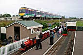 A southbound Scotrail service passes Kerrs Miniature Railway at Arbroath. July 2004.
