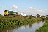 A Freightliner Class 66 runs alongside the  Oxford canal at Ansty in Warwickshire. August 2004