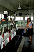 Signaller at Wroxham signal box, East Anglia. C1995.