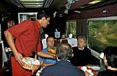 Sir Richard Branson joins Virgin colleagues for breakfast on an early morning trip from London, Euston to Manchester. 2003