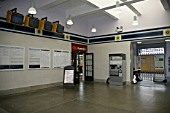 Refurbished ticket hall at Dover Priory station with timetables, train annunciators and ticket machine. 2007