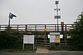Pedestrian access to the platform, signage, public. address and timetables at Monks Risborough station, Buckinghamshire. 2007