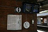 Timetables, information point and departure screens at Purley station, Greater London. 2007