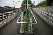 Pedestrian access ramp to the platform at Urmston station, Greater Manchester. 2007