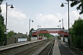 View of the platforms and newly refurbished lighting and footbridge at Codsall station, Staffordshire. 2007