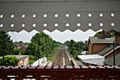 View of the station buildings and track from the newly refurbished footbridge at Codsall station, Staffordshire. 2007