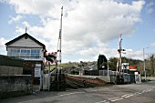 Signal box and level crossing at the entrance to Lostwithiel station, Cornwall. 2006