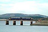 Autumn in the Lake District sees a Pacer crossing the Kent estuary with a Liverpool Lime St - Sellafield local service. October 2003.