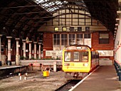 The cavernous interior of Darlingtons ECML station dominates the Pacer unit waiting to depart with a local service to Saltburn. November 2003.