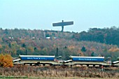 The Angel of the North dominates the railway scene in the Team Valley including Tyne Yard as in this scene with infrastructure ballast trains standing in its shadow. November 2003.
