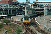The boundaries of Merseyrail services include Southport where both EMU and DMU services operate, albeit normally operated by separate TOCs. A Pacer unit departs from the DMU side of the station with a Southport - Rochdale service operated by First North Western. September 2003.