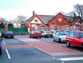 The Merseyrail operation includes many park and ride stations where the stations try to reflect the area in which they are located. This is exemplified at Aintree where the famous racecourse is directly opposite the station and the station is decorated with associated insignia and artwork. November 2003.