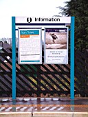 The TOCs need to impose their identity very quickly and the application of paints to station infrastructure is one of the most obvious places to display this. The Arriva Trains house livery of blue is seen displayed on this sign at Hammerton station, one of the stations in the TOCs operating area. December 2003.