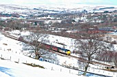 The passenger service between Cardiff and Rhymney is operated by locomotives and stock on Saturdays as in early 2004 when an overnight snowstorm added to the charm at Pontlottyn as a Rhymney - Cardiff service descended the valley. February 2004.