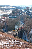 The passenger service between Cardiff and Rhymney is operated by locomotives and stock on Saturdays as in early 2004 when an overnight snowstorm added to the charm at Bargoed as a Cardiff - Rhymney service crosses the viaduct as it leaves the station. February 2004.