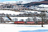 The passenger service between Cardiff and Rhymney is operated by locomotives and stock on Saturdays as in early 2004 when an overnight snowstorm added to the charm at Pontlottyn as a Cardiff - Rhymney service neared journeys end. February 2004.