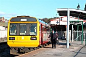The end of the Cardiff Valleys route is at Barry, once an important transit point for coal but now simply a seaside resort with a terminal station at Barry Island. A local train stands in Barry Island as the driver changes ends prior to returning to Caerphilly. February 2004.