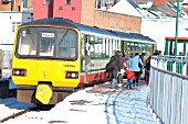 Merthyr is one of the terminal stations for Valley Line trains out of Cardiff and an overnight snow storm led to an attractive scene in early 2004 as passengers detrained from a service which had just arrived from Cardiff. February 2004.