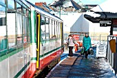 Merthyr is one of the terminal stations for Valley Line trains out of Cardiff and an overnight snow storm led to an attractive scene in early 2004 as passengers boarded a train waiting to return to Cardiff. February 2004.