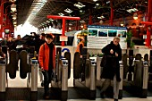 Passengers walk through the ticket barriers at Marylebone having arrived on a local service. February 2005.