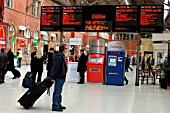 A view of the main concourse at Marylebone showing automatic ticket machines and computerised departure board. February 2005.